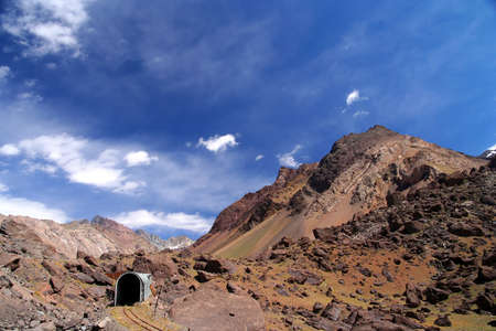 Disused railway track leading into the tunnel high in the argentinian Andes Stock Photo - 13295199