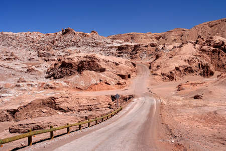 Road through the famous Valle the la Luna near San Pedro de Atacama in Chile photo