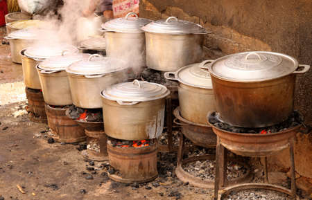 meal preparation: African aluminium cooking pots on the fire Stock Photo