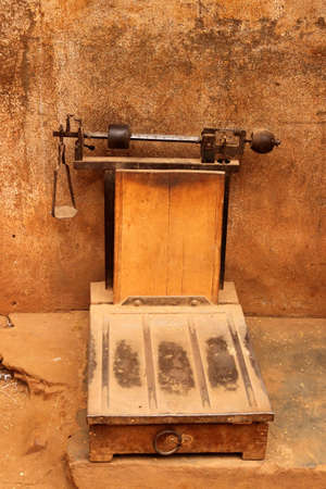 Old traditional scale to weight rice on the market in Ambalavao, Madagascar photo