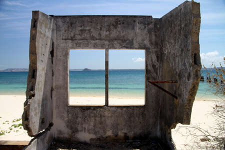 Remains of the building destroyed by the ocean on the northern coast of Madagascar, near Diego Suarez photo