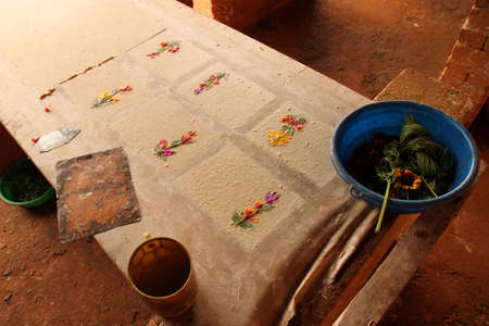 Pages of hand made paper decorated with dried flowers, traditional paper faktory, Ambalavao, Madagascar