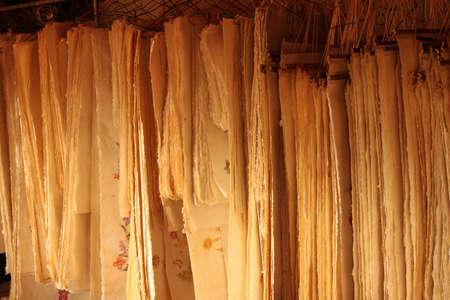 traditionary: Sheets of paper Hanging In a storage, traditional paper factory, Ambalavao, Madagascar Stock Photo