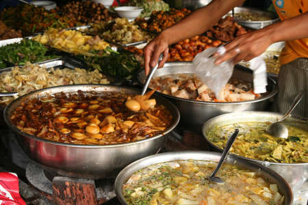 food buffet: Ready meals for sale on the market in Phnom Penh, Cambodia Stock Photo