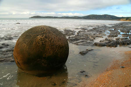 Moeraki boulders on the beach during low tide, Moeraki, New Zealand photo