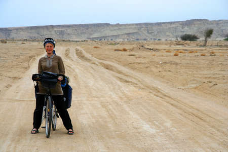 Woman on a cycle touring trip in Queshm island in Iran photo