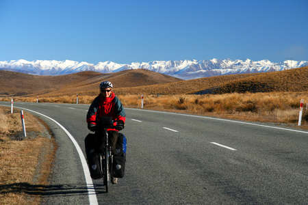 Woman on a cycle touring trip in New Zealand photo