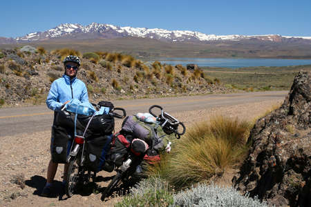 oamaru: Woman cyclist taking a break during touring trip in Patagonia, Argentina Stock Photo