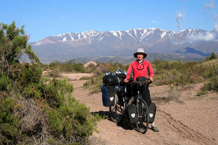 Woman cyclist having break while travelling through remote parts of northern Argentina photo