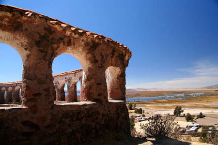 Old inca ruins ( old Lupaca ceremonial center ) near Puno, with the view of Lake Titicaca, Peru