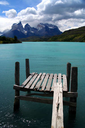 paine: Wooden platform on a lake with a view of Cuernos del Paine, Patagonia, Chile