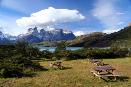del: Tables on the grass on the camping site near the stunning Cuernos del Paine in southern Chile Stock Photo