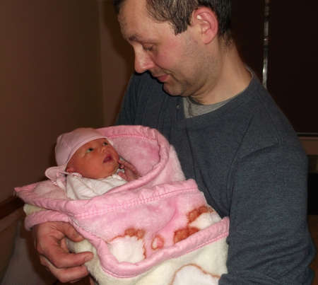 Father holding newborn baby daughter Stock Photo - 15475996