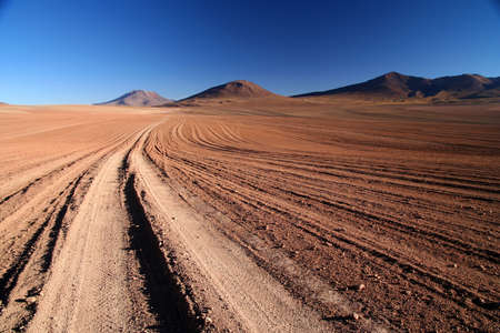 Desert road through remote part of southern Altiplano photo