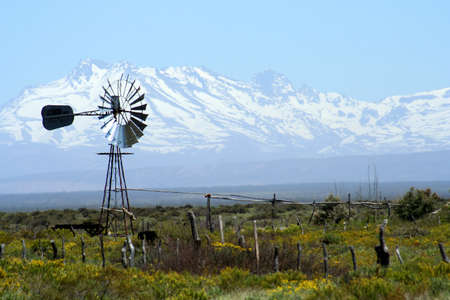 Abandoned farm near Mendoza in Argentina with Andes in the background photo