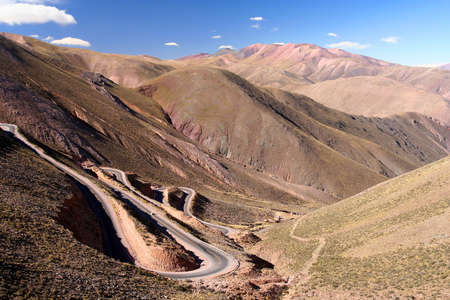 Twisting road from the high plateau to Quebrada de Humahuaca mountains in northern Argentina photo