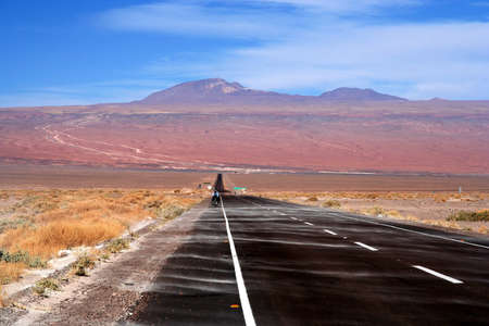 Road leading from San Pedro de Atacama in Chile to the high Altiplano plateau, climbing 2000m to almost 5000 metres above sea level photo