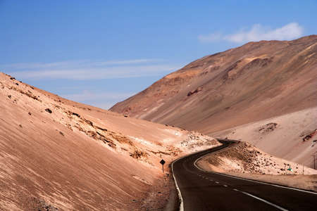 Road leading from Arica in Chile to the bolivian border high on the plateau, climbing to almost 5000 metres above sea level photo