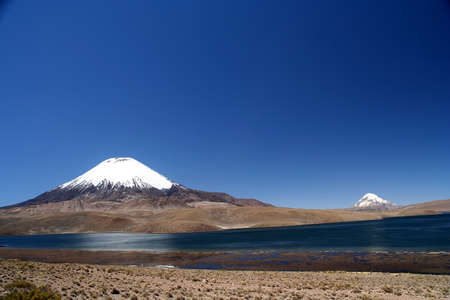 Snowcapped Parinacota volcano in Park Lauca in Chile Stock Photo - 15662211