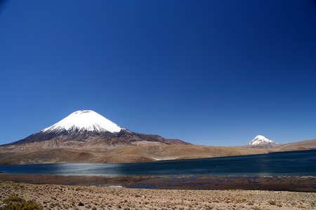 Snowcapped Parinacota volcano in Park Lauca in Chile Stock Photo - 15662211