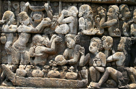 reliefs: Market scene sculpture on the wall at Borobudur on Java, Indonesia Stock Photo