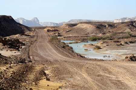 rocky road: Gravel road through  the Quesh island, the biggest island in the Strait of Hormuz