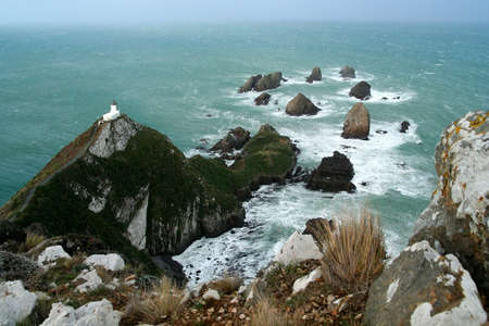 Lighthouse on the Nugget Point � stunning part of New Zealand south Island coast photo