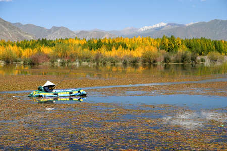 Man fishing on a lake in Eastern Tibet photo