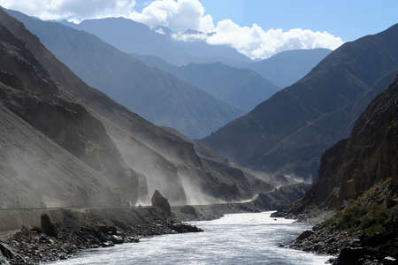 Dusty mountain road from Eastern Tibet to Yunnan province in China  photo