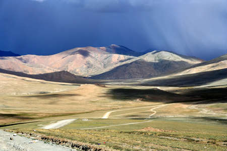 Mountain road through the high central Tibetan plateau, Tibet, China Stock Photo - 16777244