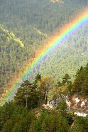 Rainbow over mountain road in mountains in Yunnan, China photo