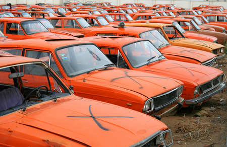 """Cementary"" of disused and broken Paykans – Iranian national cars"