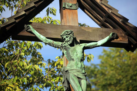 Sculpture of a Jesus on a cross outside St  Peter's church in London photo