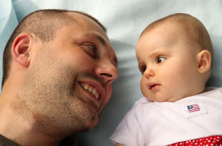 6 month old: Father looking into the eyes of his 6 month old daughter Stock Photo