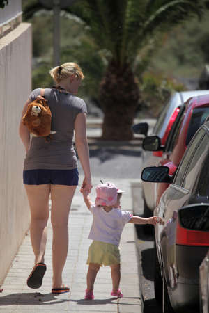 Mother and daughter going for a walk in a tropical island La Gomera in the Canary Islands, Spain photo