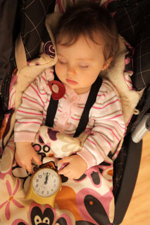 Little cute baby girl sleeping in her pushchair photo