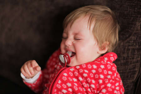 Upset and angry baby girl crying loudly Stock Photo - 20077722