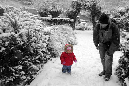 Father with his daughter walking in the park on a cold winter day photo