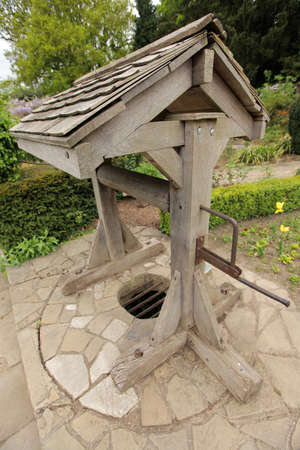 draw well: Old disused wooden traditional well in the Streatham Common Park in London