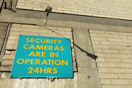 cams: Board informing that security cameras are in operation 24hrs Stock Photo