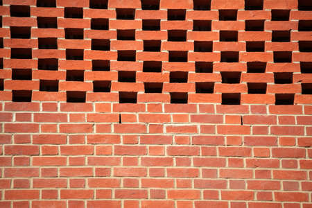 alternating: Red bricks wall pattern in a newly constructed building Stock Photo
