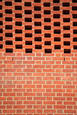 Red bricks wall pattern in a newly constructed building - vertical picture photo