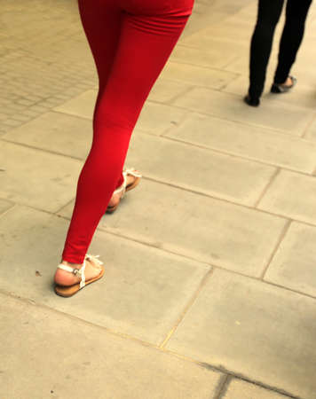 Woman in red jeans walking on the London street photo
