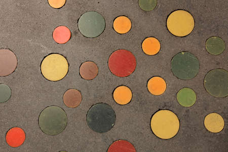 Colourful circle pattern on the pavement on london street photo