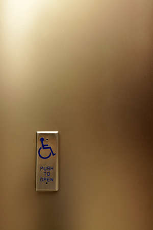Push to open button - automatic door opener for wheelchair accessibility photo