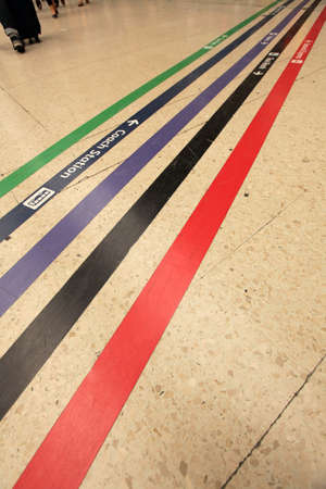 Colourful lines directing passengers towards various points from the station such as couch station, taxi rank, toilets, etc , Victoria train station in London, UK photo