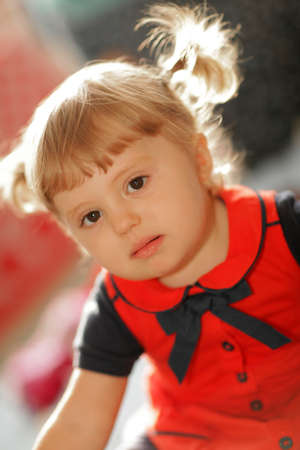 ponytails: Portrait of a cute little baby girl with the ponytails Stock Photo