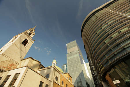 Old Church next to the futuristic building near the Cannon street station in London, England