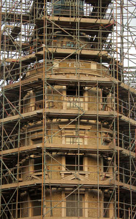 buildingsite: Scaffolding on an old victorian building being renovated, London Stock Photo