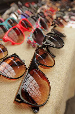 Sunglasses on sale on the market Imagens
